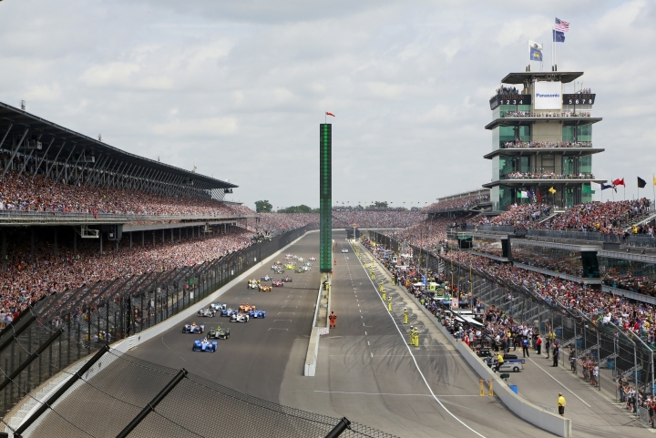 Scott Dixon, of New Zealand, leads the field into the first turn on the start of the Indianapolis 500 auto race at Indianapolis Motor Speedway, Sunday, May 28, 2017, in Indianapolis. (AP Photo/R Brent Smith)
