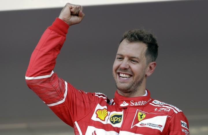 Ferrari driver Sebastian Vettel of Germany celebrates after winning the Formula One Grand Prix at the Monaco racetrack in Monaco, Sunday, May 28, 2017. (AP Photo/Claude Paris)