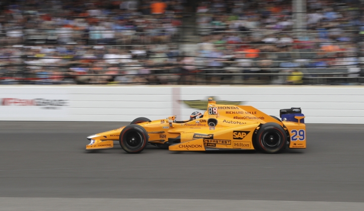 Fernando Alonso, of Spain, heads into the first turn during the running of the Indianapolis 500 auto race at Indianapolis Motor Speedway, Sunday, May 28, 2017, in Indianapolis. (AP Photo/Darron Cummings)