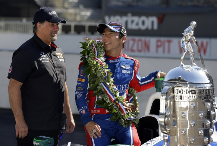 Indianapolis 500 champion Takuma Sato, of Japan, car owner Michael Andretti chat during the traditional winners photo session on the start/finish line at the Indianapolis Motor Speedway in Indianapolis, Monday, May 29, 2017. (AP Photo/Michael Conroy)