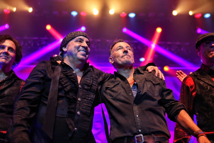 "In this Saturday, May 27, 2017 photo, Bruce Springsteen, right, performs at the Count Basie Theatre in Red Bank, N.J., with rocker Steven Van Zandt, left, during the show's encore. Springsteen performed a handful of songs including ""Tenth Avenue Freeze-Out"" when Van Zandt surprised guests and invited Springsteen on stage. (Amanda Stevens/Count Basie Theatre via AP)"