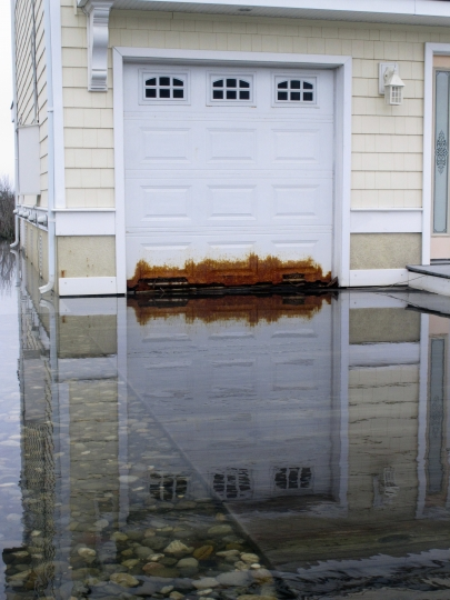 This April 26, 2017 photo shows a garage door on a home in Ocean City on the edge of a back bay that floods regularly, and has rusted the metal door. Scientists and people living in back-bay areas behind barrier islands say flooding is increasing, even as the problem gets less attention and money than flooding along the ocean. (AP Photo/Wayne Parry)
