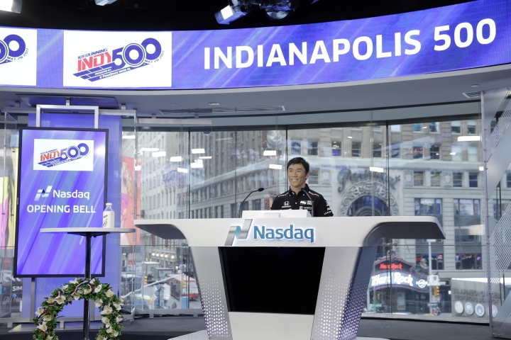 Takuma Sato, the 2017 Indianapolis 500 winner, delivers his remarks before ringing the opening bell at the Nasdaq MarketSite, in New York's Times Square, Tuesday, May 30, 2017. (AP Photo/Richard Drew)