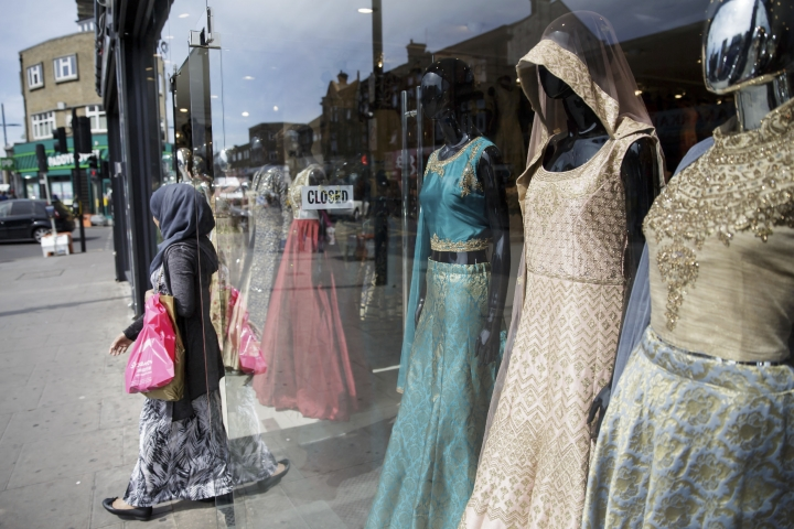 """A person shops at Upton Park, in London, Monday May 22, 2017. """"Mainstream fashion is now talking about modest fashion as a thing. Ten years ago, if you were a brand coming from a religious background and tried to sell it in department stores, calling it a modest or Muslim brand would be a kiss of death,"""" said Reina Lewis, a professor at the London College of Fashion who has written two books about the topic. While the majority of those interested in covered-up fashion are young, cosmopolitan Muslim women, """"the term 'modesty' emerged in the niche market as a useful one because it's not faith-specific,"""" Lewis added. (AP Photo/Tim Ireland)"""