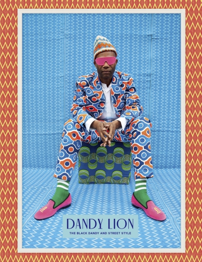 """This cover image released by Aperture shows, """"Dandy Lion: The Black Dandy and Street Style,"""" written by Shantrelle P. Lewis. (Aperture via AP)"""