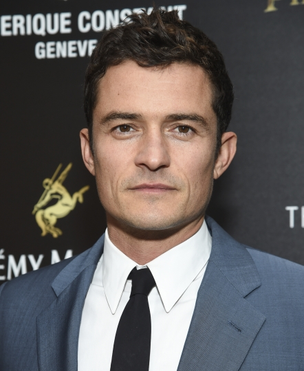 """FILE - In this May 23, 2017 file photo, actor Orlando Bloom attends a special screening of Walt Disney Studios' """"Pirates of the Caribbean: Dead Men Tell No Tales"""", in New York. Bloom will serve as a presenter at this year's Tony Awards on June 11. (Photo by Evan Agostini/Invision/AP, FIle)"""