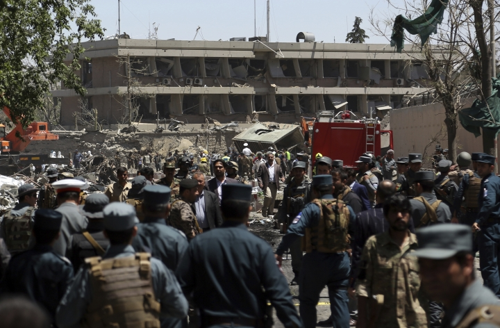 Security forces inspect the site of a suicide attack where the German Embassy is located in Kabul, Afghanistan, Wednesday, May 31, 2017. A massive explosion rocked a highly secure diplomatic area of Kabul on Wednesday morning, causing casualties and sending a huge plume of smoke over the Afghan capital. (AP Photos/Rahmat Gul)