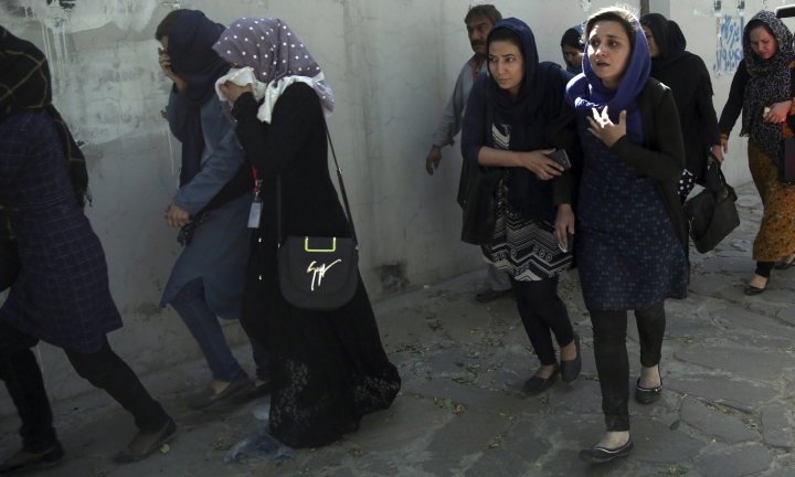 Roshan mobile company employees leave the site of a suicide attack in Kabul, Afghanistan, Wednesday, May 31, 2017. A massive explosion rocked a highly secure diplomatic area of Kabul on Wednesday morning, causing casualties and sending a huge plume of smoke over the Afghan capital. (AP Photos/Massoud Hossaini)