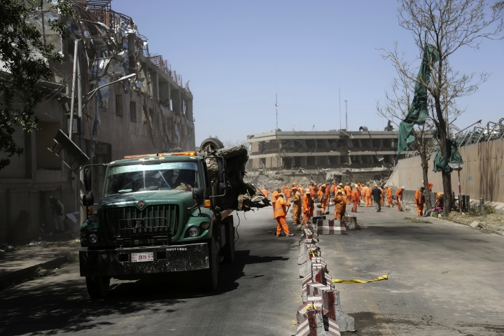 Afghan Municipality workers sweep a road in front of the German Embassy after a suicide attack in Kabul, Afghanistan, Wednesday, May 31, 2017. A massive explosion rocked a highly secure diplomatic area of Kabul on Wednesday morning, causing a big number of casualties and sending a huge plume of smoke over the Afghan capital. (AP Photos/Rahmat Gul)