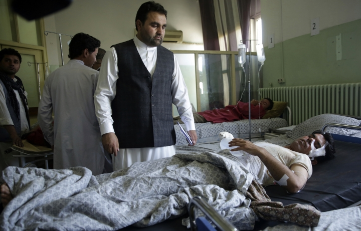 Wounded men lie on their beds in Wazir Akbar Khan Hospital in Kabul, Afghanistan, Wednesday, May 31, 2017. A massive explosion rocked a highly secure diplomatic area of Kabul on Wednesday morning, causing casualties and sending a huge plume of smoke over the Afghan capital. (AP Photos/Massoud Hossaini)