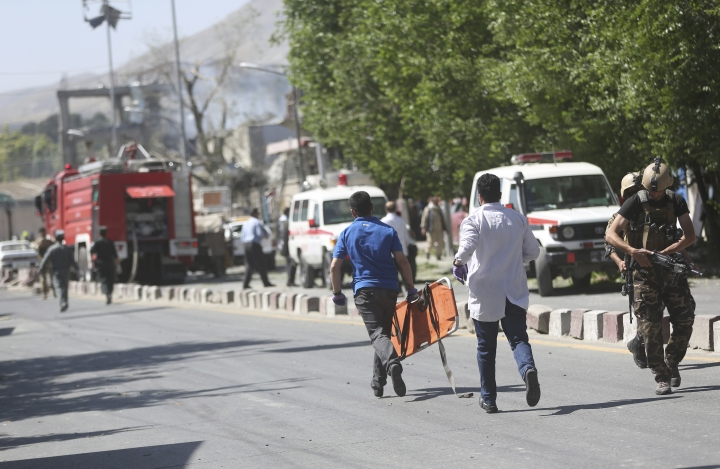 Medic personnel run to the site of an explosion in Kabul, Afghanistan, Wednesday, May 31, 2017. A massive explosion rocked a highly secure diplomatic area of Kabul on Wednesday morning, causing casualties and sending a huge plume of smoke over the Afghan capital. (AP Photos/Massoud Hossaini)