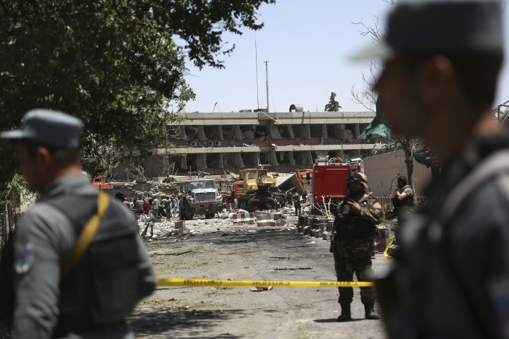 Security forces operate near the site of a suicide attack where the German Embassy is located in Kabul, Afghanistan, Wednesday, May 31, 2017. A massive explosion rocked a highly secure diplomatic area of Kabul on Wednesday morning, causing casualties and sending a huge plume of smoke over the Afghan capital. (AP Photos/Rahmat Gul)