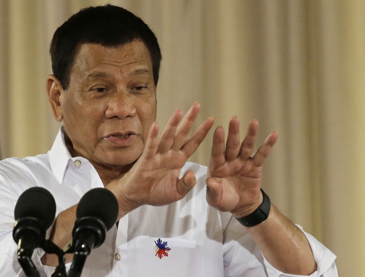 Philippine President Rodrigo Duterte gestures during his speech at a swearing in ceremony of officials of various municipalities at the Malacanang presidential palace in Manila, Philippines on Thursday, June 1, 2017. During the speech Duterte denounced Chelsea Clinton in an expletive-laden speech for the second straight day after she criticized a comment he made about rapes committed by soldiers. As its usual practice, his office muted the foul language in an edited video of his speech. (AP Photo/Aaron Favila)
