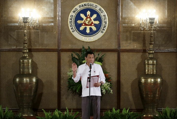 Philippine President Rodrigo Duterte officiates the oath taking of officials at the Malacanang presidential palace in Manila, Philippines on Thursday, June 1, 2017. (AP Photo/Aaron Favila)