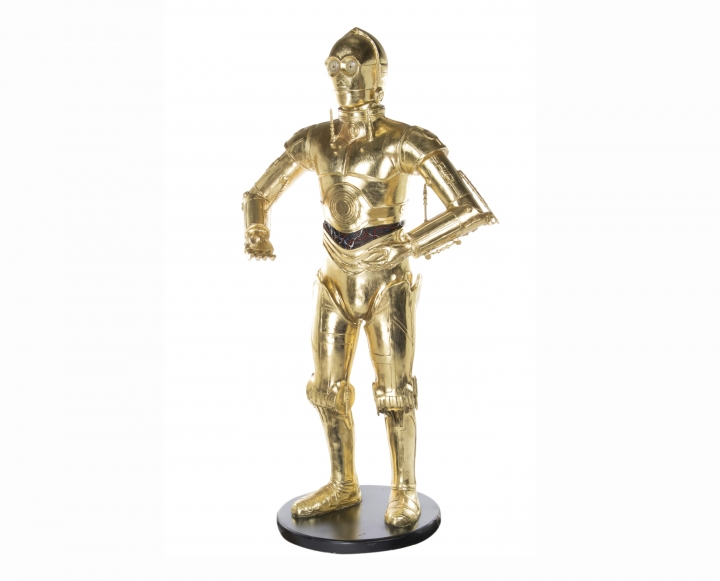 """This image re;eased by Profiles in History shows a life size model of C-3PO, from the """"Star Wars"""" franchise, belonging to the late actress Carrie Fisher. The item is among many belongings of Fisher and her mother Debbie Reynolds up for auction beginning September 23. (Profiles in History via AP)"""
