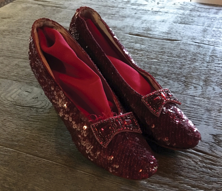 "This image released by Profiles in History shows a pair of replica ruby slippers from ""The Wizard of Oz,"" which is a part of a memorabilia collection owned by the late Debbie Reynolds. The slippers are among many items belonging to Reynolds and her daughter Carrie Fisher that will be up for auction beginning September 23. (Profiles in History via AP)"
