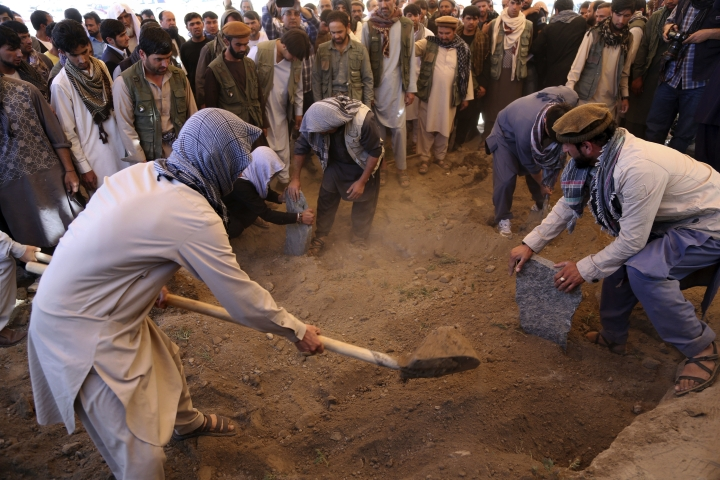 Afghans bury a victim of Wednesday's massive bombing, in the capital, Kabul, Afghanistan, Thursday, June 1, 2017. Afghans are mourning the loss of family members, friends and colleagues a day after the truck bomb left at least 90 people dead and over 400 others wounded. (AP Photo/Rahmat Gul)