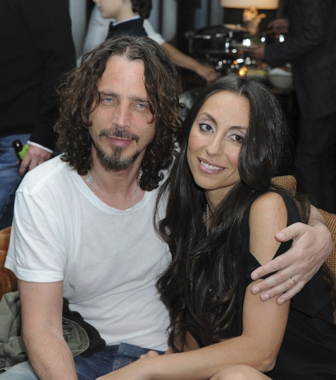 "FILE - In this April 27, 2012, file photo, Chris Cornell, at left, and his wife, Vicky Karayiannis attend the celebration of ""Commando: The Autobiography of Johnny Ramone,"" in Los Angeles. Vicky Cornell. Cornell says in a statement Thursday, June 1, 2017 that she's still awaiting toxicology reports she hopes will clarify the circumstances around her late husband's apparent suicide. (AP Photo/Katy Winn, File)"