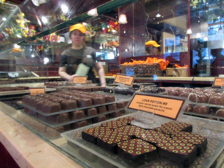 This April 28, 2017 photo shows a display of chocolates at Jacques Torres, a chocolatier in the DUMBO section of Brooklyn, N.Y. Jacques Torres is one of the stops on A Slice of Brooklyn's chocolate tour. In addition to chocolate samples to taste, the tour offers a peek at the chocolate-making process and interesting neighborhoods along with insight into how some of the businesses got started. (AP Photo/Beth J. Harpaz)