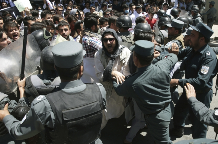 Police forces clash with protesters during a demonstration in Kabul, Afghanistan, Friday, June 2, 2017. Hundreds of demonstrators demanded better security in the Afghan capital in the wake of a powerful truck bomb attack that killed scores of people. (AP Photos/Massoud Hossaini)