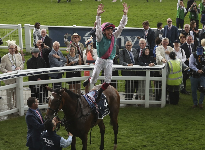 Jockey Frankie Dettori celebrates after winning the Investec Oaks with horse Enable, on Ladies Day during the 2017 Epsom Derby Festival at Epsom Racecourse, Epsom, England, Friday, June 2, 2017. (Adam Davy/PA via AP)