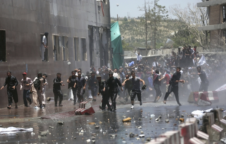 Protesters throw stones toward security forces during a demonstration in Kabul, Afghanistan, Friday, June 2, 2017. Hundreds of demonstrators demanded better security in the Afghan capital in the wake of a powerful truck bomb attack that killed scores of people. (AP Photos/Massoud Hossaini)