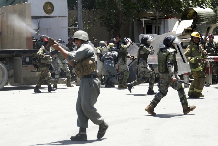 Police forces run as protesters throw stones in Kabul, Afghanistan, Friday, Jun 2, 2017. Some 500 people are demonstrating in Kabul for better security in the Afghan capital in the wake of a powerful truck bomb attack that killed 90 people. (AP Photos/Massoud Hossaini)