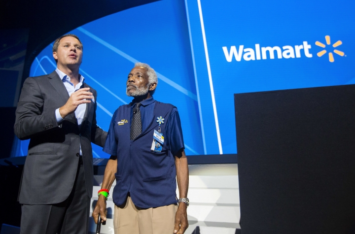 Walmart CEO Doug McMillon talks about employee Willie Perkins during the Walmart shareholders meeting Friday, June 2, 2017, at Bud Walton Arena in Fayetteville, Ark. (Jason Ivester/The Northwest Arkansas Democrat-Gazette via AP)