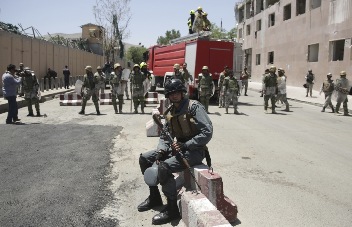 A policeman rests during a demonstration in Kabul, Afghanistan, Friday, June 2, 2017. Hundreds of demonstrators demanded better security in the Afghan capital in the wake of a powerful truck bomb attack that killed scores of people. (AP Photo/Massoud Hossaini)