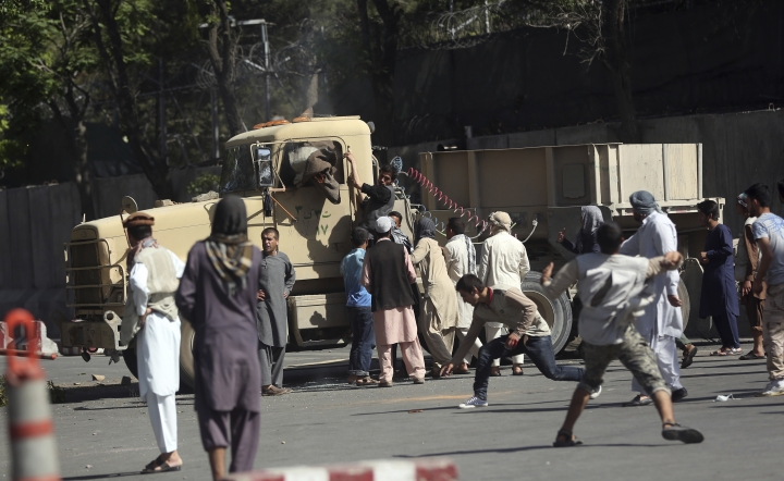 Angry protesters start a fire inside the cab of military vehicle during a violent demonstration near the Wednesday's suicide attack site, in Kabul, Afghanistan, Friday, Jun 2, 2017. The demonstration in downtown Kabul that left several people dead has entered a second day. (AP Photos/Massoud Hossaini)