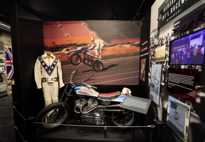 The cycle and leathers used by Evel Knievel at his Kansas City International Speedway jump are on display at the Evel Knievel Museum in Topeka, Kan., Friday, June 2, 2017. A new Kansas museum is giving enthusiasts of late motorcycle daredevil Evel Knievel a jump on appreciating his death-defying, bone-breaking exploits. The $5-million, 13,000-square-foot homage to the man famous for rocket-powered and motorbike stunts before his 2007 death has opened in Topeka. (AP Photo/Orlin Wagner)
