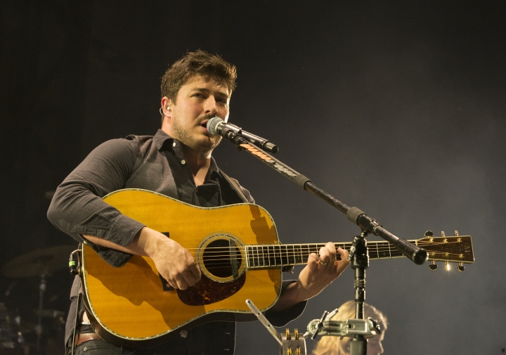 "FILE - In this Thursday, May 25, 2017 file photo, Marcus Mumford of the band Mumford & Sons performs in concert during their ""Wilder Mind Tour"" at the BB&T Pavilion in Camden, N.J. Mumford is joining the all-star lineup for Ariana Grande's ""One Love Manchester"" benefit concert Sunday, June 4, 2017. Show organizers announced Saturday, June 3, that the frontman of the group Mumford & Sons will join Grande, Coldplay and other stars at the concert raising money for victims of the May 22 suicide attack in Manchester, England. (Photo by Owen Sweeney/Invision/AP, File)"