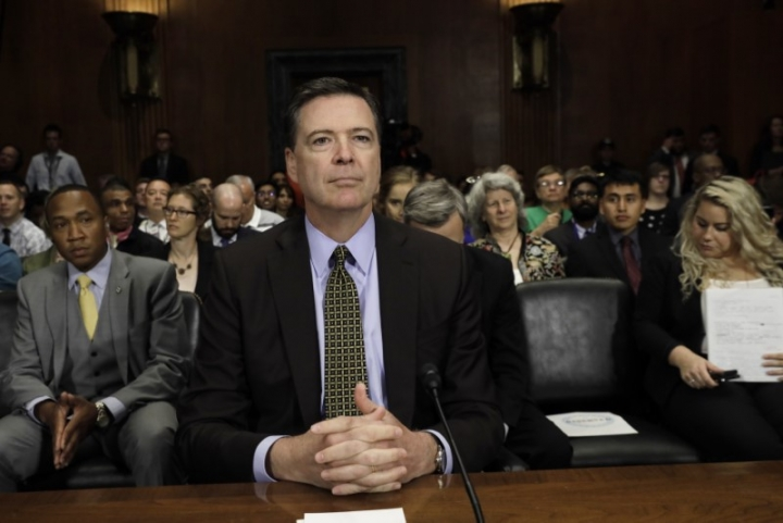 """FILE PHOTO - FBI Director James Comey prepares to testify before a Senate Judiciary Committee hearing on """"Oversight of the Federal Bureau of Investigation"""" on Capitol Hill in Washington, U.S., May 3, 2017. REUTERS/Kevin Lamarque"""