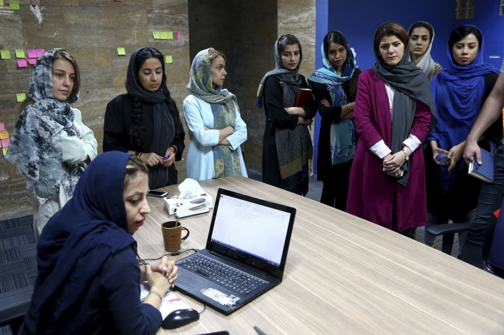 In this Sunday, May 22, 2017, photo, staffers of the Bamilo online shopping site attend a meeting at their office in Tehran, Iran. Iran remains in many ways cut off economically from the rest of the world, fueling a surprisingly active local tech startup scene. It's driven by a growing number of Iranian millennials who see their country as a market ripe with opportunity. (AP Photo/Ebrahim Noroozi)