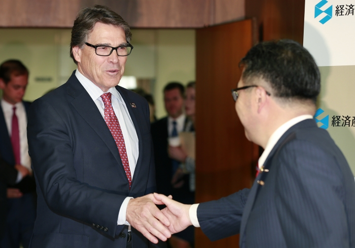 U.S. Energy Secretary Rick Perry, left, shake hands with Japanese Economy, Trade and Industry Minister Hiroshige Seko prior to their meeting at Seko's ministry in Tokyo, Monday, June 5, 2017. (AP Photo/Shizuo Kambayashi)