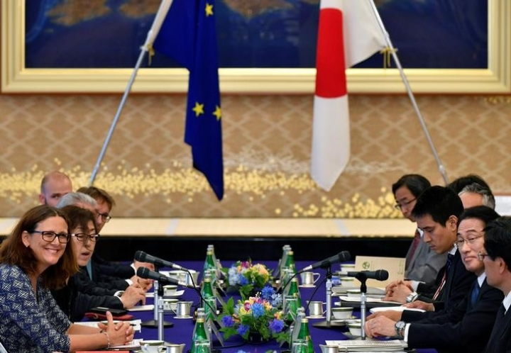 FILE PHOTO - European Commissioner for Trade Cecilia Malmstrom (L) and Japanese Foreign Minister Fumio Kishida (2nd R) attend their meeting as a part of the Japan-EU Economic Partnership Agreement negotiations at Iikura guest house in Tokyo, Japan 30 June 2017. REUTERS/Franck Robichon/Pool