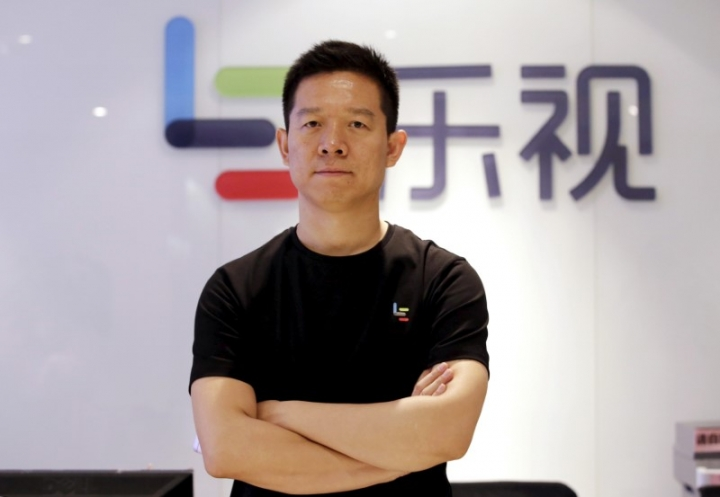 FILE PHOTO: Jia Yueting, co-founder and head of Le Holdings Co Ltd, also known as LeEco and formerly as LeTV, poses for a photo in front of a logo of his company after a Reuters interview at LeEco headquarters in Beijing, China April 22, 2016. REUTERS/Jason Lee/File Photo