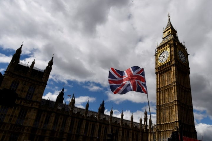 FILE PHOTO - The Union Flag flies near the Houses of Parliament in London, Britain, June 7, 2017. REUTERS/Clodagh Kilcoyne/File Photo