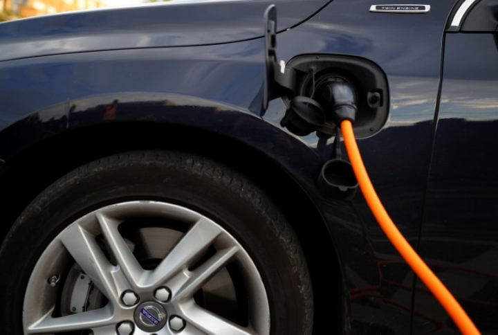 A Volvo hybrid car is seen connected to a charging point in this picture illustration taken July 6, 2017. REUTERS/Phil Noble/Illustration