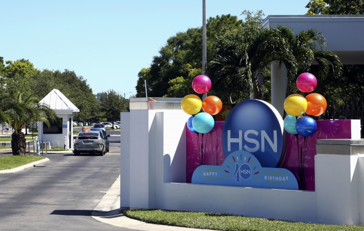 This photo shows a sign outside of the headquarters of the Home Shopping Network on Thursday, July 6, 2017, in St. Petersburg, Fla. QVC's parent company is taking control of the Home Shopping Network for about $2.6 billion in stock to create what they say will be the third-largest e-commerce company in the United States. (Scott Keeler/Tampa Bay Times via AP)