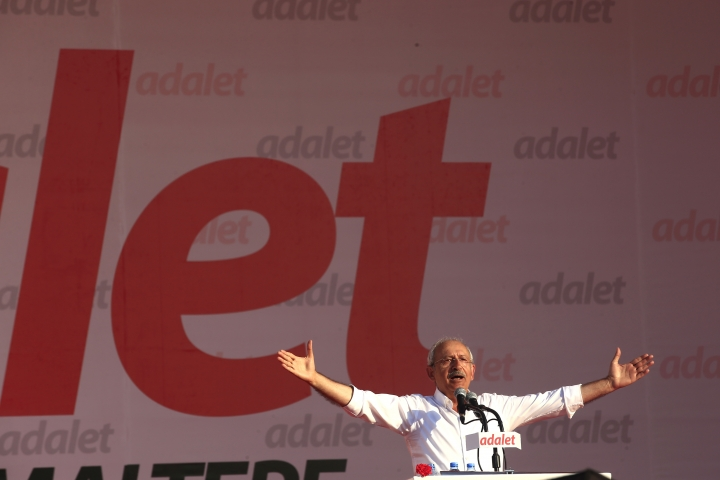 Kemal Kilicdaroglu, the leader of Turkey's main opposition Republican People's Party, talks during a rally following his 425-kilometer (265-mile) 'March for Justice' in Istanbul, Sunday, July 9, 2017. Kilicdaroglu along with thousands of supporters walked from the capital Ankara to an Istanbul prison, began to denounce the imprisonment of a party lawmaker but has grown into a wider protest of Turkey's President Recep Tayyip Erdogan's policies and the large-scale government crackdown on opponents in the wake of July 2016's failed coup attempt. (AP Photo/Lefteris Pitarakis)