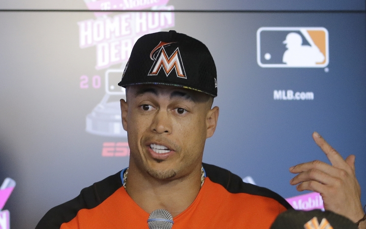 Miami Marlins' Giancarlo Stanton talks to reporters during a news conference before the MLB baseball All-Star Home Run Derby, Monday, July 10, 2017, in Miami. (AP Photo/Alan Diaz)