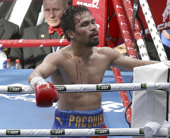 In this Sunday, July 2, 2017, file photo, Manny Pacquiao of the Philippines reacts after his loss to Jeff Horn of Australia, during their WBO World Welterweight title fight in Brisbane, Australia. (AP Photo/Tertius Pickard, File)