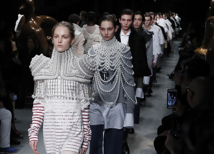 FILE - In this Monday, Feb. 20, 2017 file photo, models display creations by Burberry during their Autumn/Winter 2017 show as part of London Fashion Week in London. British luxury fashion brand Burberry said Wednesday July 12, 2017, they saw a surprising 4 percent rise in sales in the second quarter, thanks largely to demand in mainland China. (AP Photo/Kirsty Wigglesworth, File)