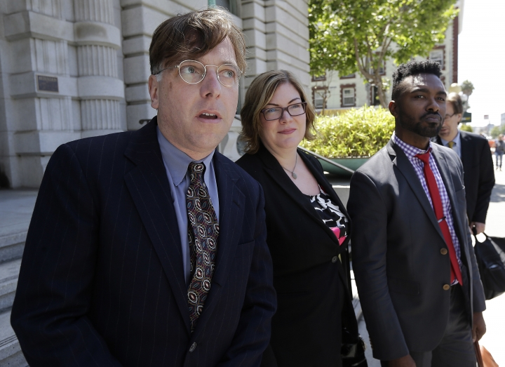 Attorney Andrew Dhuey, from left, representing photographerDavidSlater, attorney Angela Dunning, representing Blurb, a San Francisco-based self-publishing company, and Trevor Cooper, Legal Counsel at Blurb, speak to reporters outside of the 9th U.S. Circuit Court of Appeals in San Francisco, Wednesday, July 12, 2017. Attorneys for Slater, a wildlife photographer whose camera was used by a monkey to snap selfies, asked a federal appeals court to end a lawsuit seeking to give the animal rights to the photos. People for the Ethical Treatment of Animals sought a court order in 2015 allowing it to administer all proceeds from the photos to benefit the monkey. (AP Photo/Jeff Chiu)