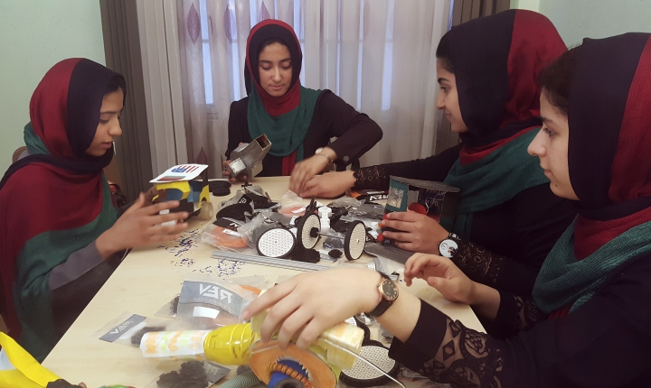 FILE- In this Thursday, July 6, 2017, file photo, teenagers from the Afghanistan Robotic House, a private training institute, practice at the Better Idea Organization center, in Herat, Afghanistan. U.S. President Donald Trump intervened to allow the group of Afghan girls into the country to participate in a robotics competition. White House spokeswoman Sarah Huckabee Sanders confirmed the president's intervention Wednesday, July 12, 2017. The six female students from Afghanistan had hoped to participate in an international robotics competition this month, but their visa applications to enter the U.S. were denied twice. (AP Photos/Ahmad Seir, File)