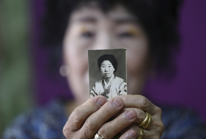 In this July 11, 2017 photo, South Korea's YouTube star, Park Makrye, 70, shows her teenage photo at her home in Yongin, South Korea. Park's videos are all about showing off her wrinkles and her elderly life in the raw. Young South Koreans find her so funny and adorable that big companies like Samsung Electronics and Lotte are banking on her popularity. But despite her new life as a celebrity, she still gets up before dawn to run her diner. (AP Photo/Lee Jin-man)