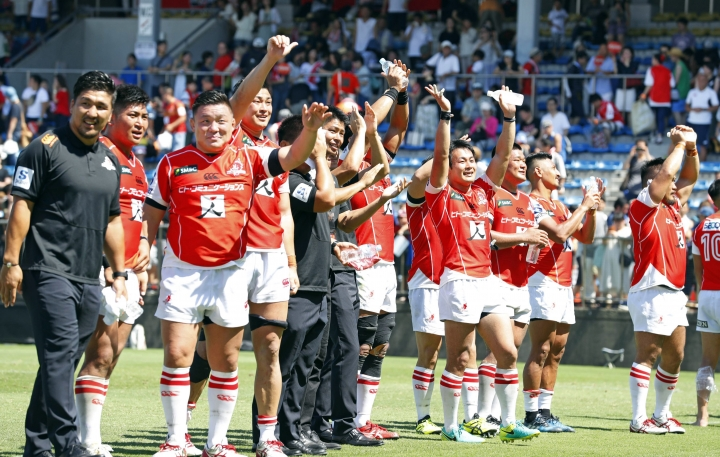 Japan's Sunwolves players celebrate their win after their rugby match against Auckland Blues in Tokyo Saturday, July 15, 2017. (Yohei Fukai/Kyodo News via AP)