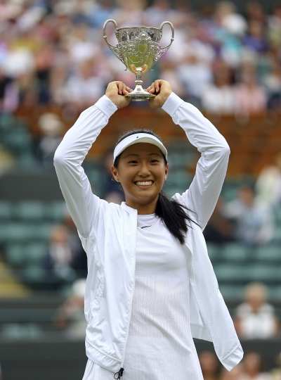 Claire Liu of the United States celebrates winning the Girls Singles final match compatriot Ann Li on day twelve at the Wimbledon Tennis Championships in London, Saturday, July 15, 2017. (Gareth Fuller/PA via AP)
