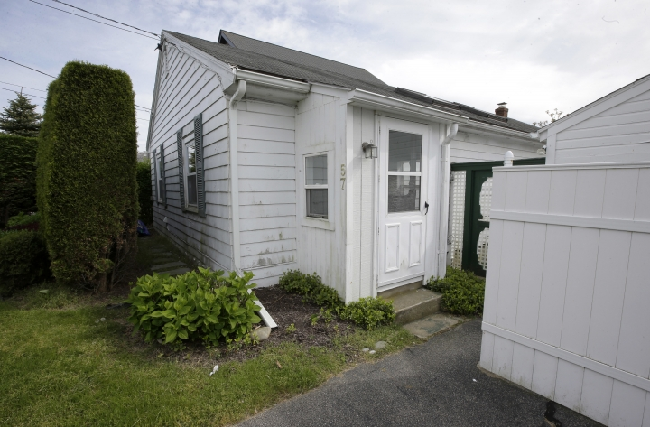 This May 23, 2017 photo, shows the childhood home of retired U.S. Army Gen. Michael Flynn, in Middletown, R.I. The former National Security Adviser, at the center of multiple probes into Russia's interference in the 2016 presidential election, is seeking sanctuary from the swirling eddy of news coverage in the beach town where he grew up. (AP Photo/Steven Senne)